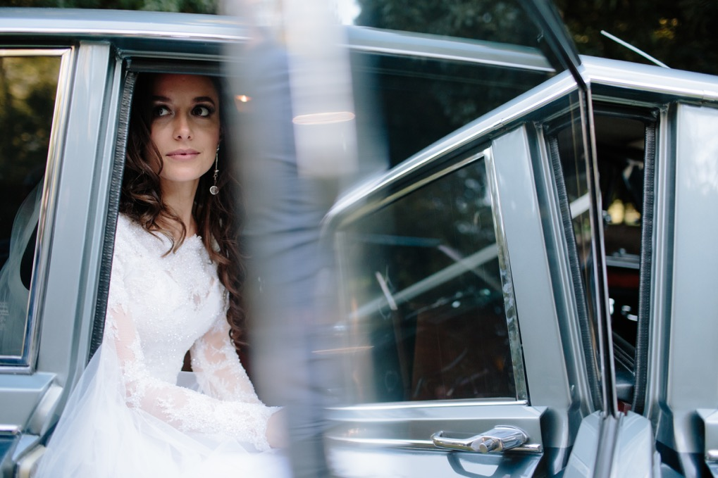 Bride in Daimler DS420 Classic wedding car