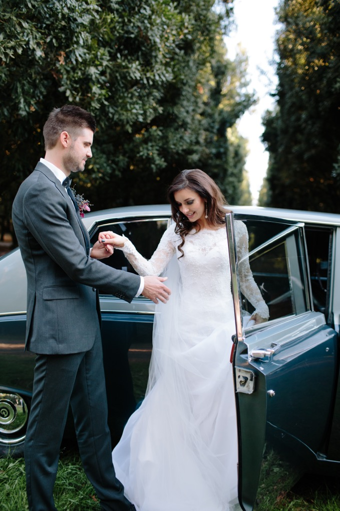 Bride and groom with Daimler DS420 Classic wedding car