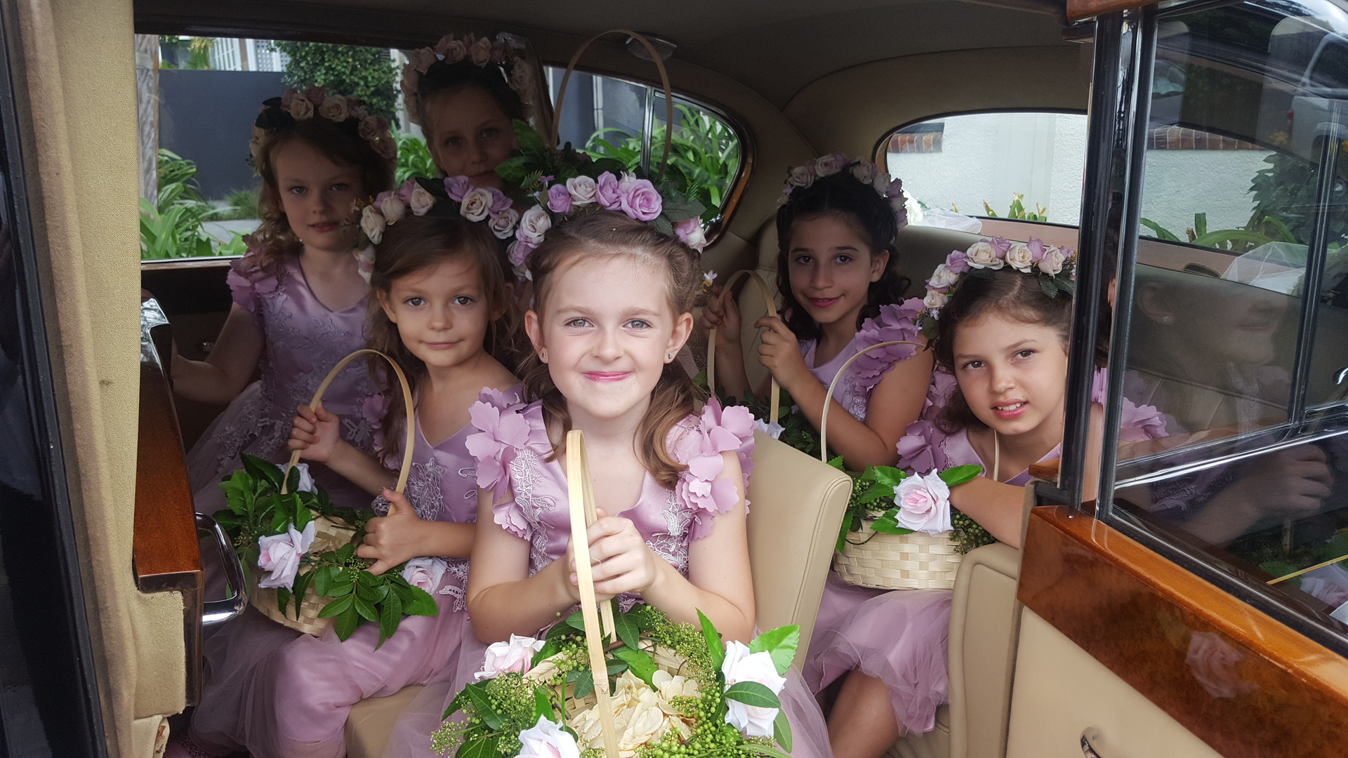 flower girls inside the vanden plas princess wedding car