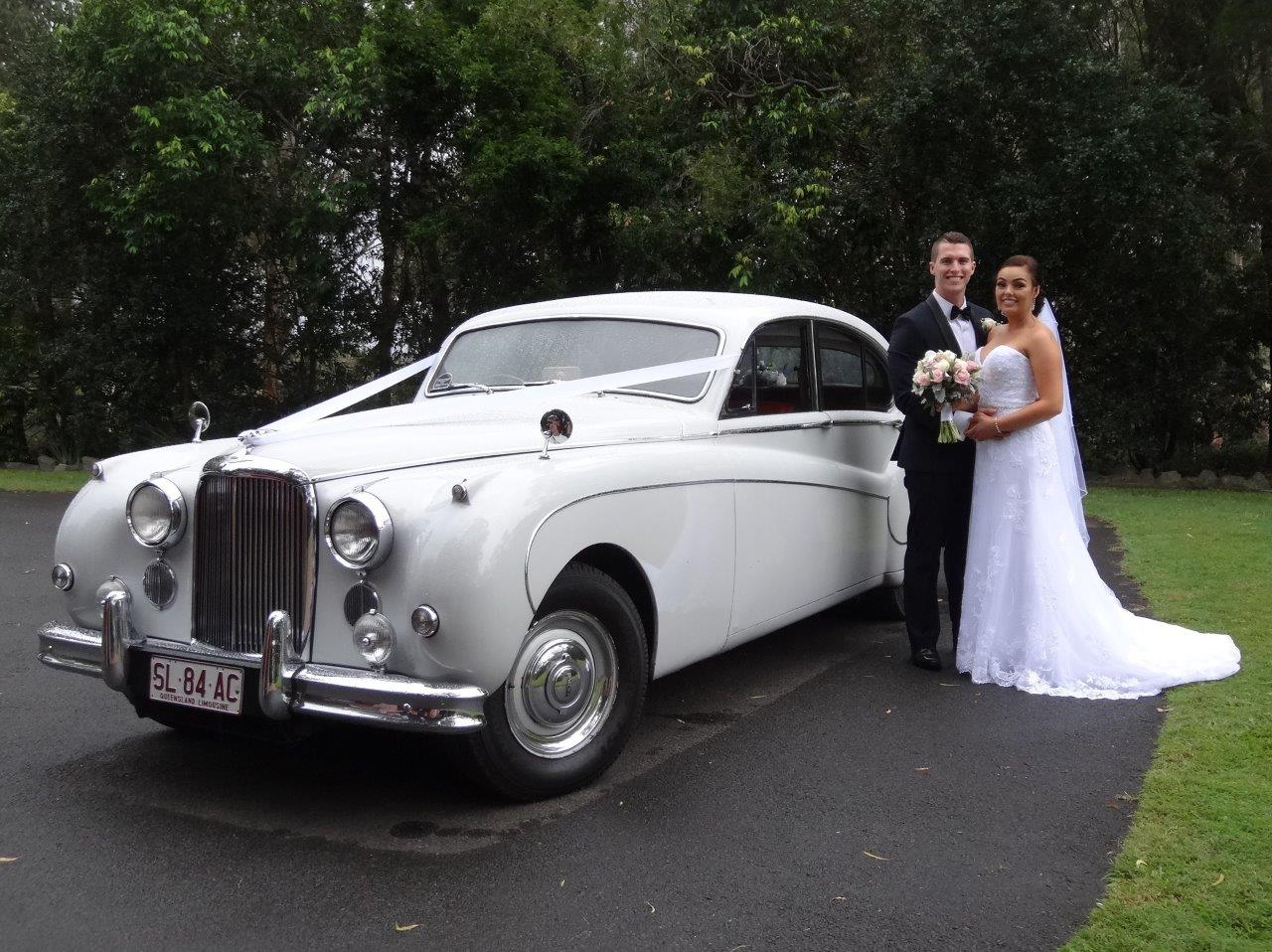 Jaguar Wedding Car with bride and groom