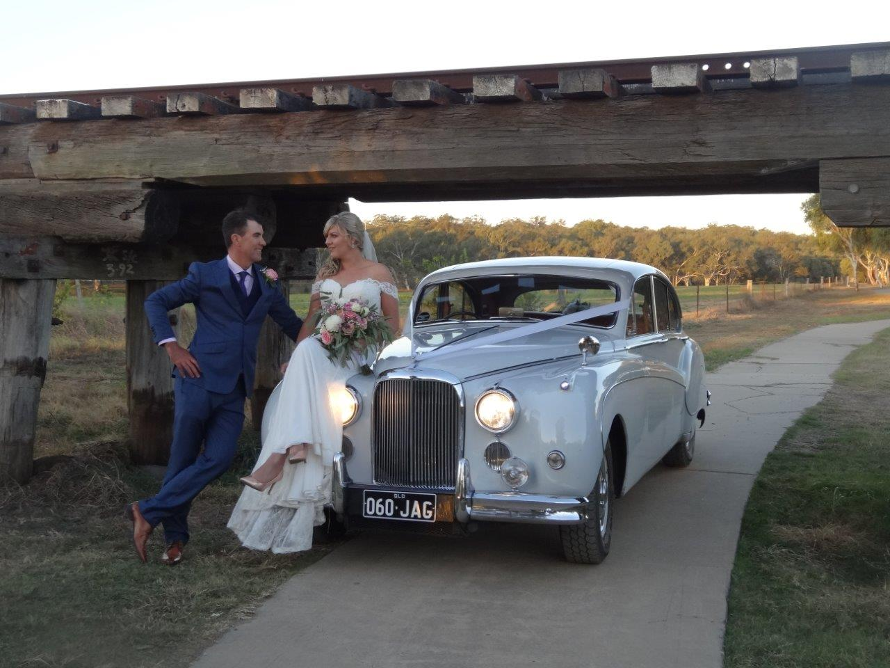 Bride and groom with wedding car | Jaguar