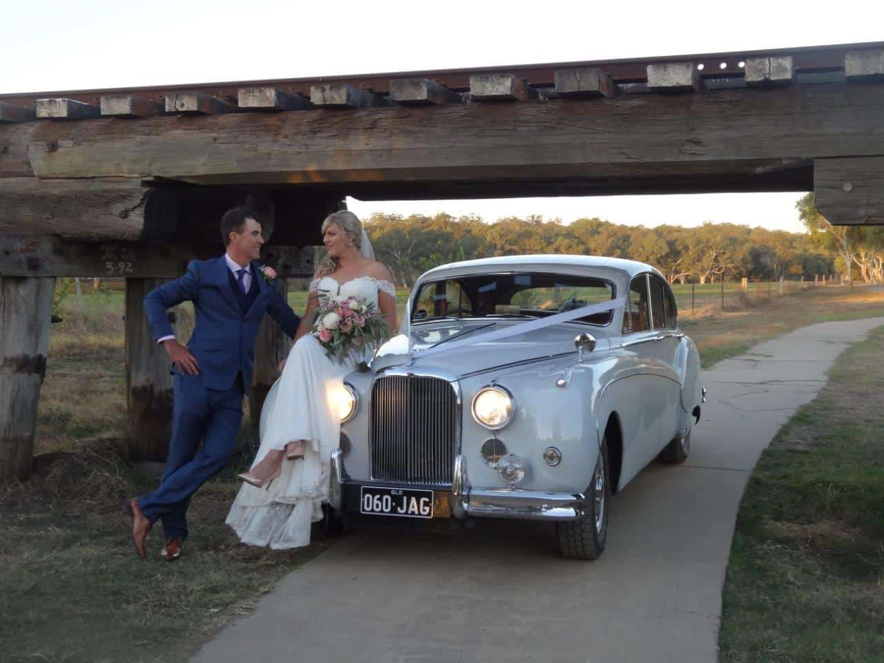 Jag Wedding car with bride & groom