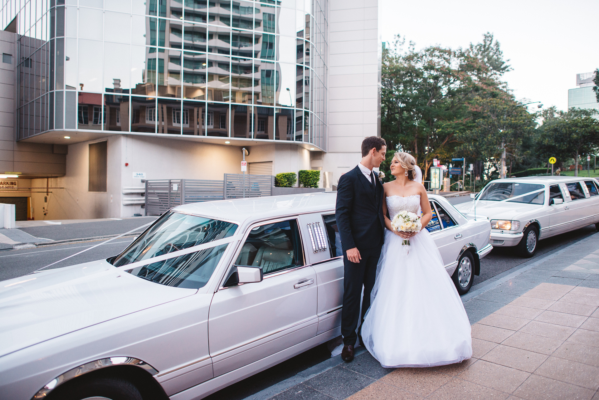Bride and groom in city Classic Mercedes Benz Stretch