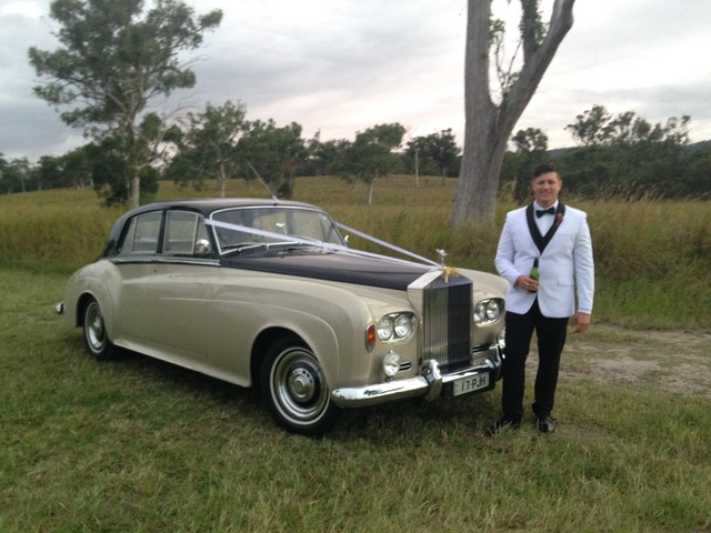 1960's Rolls Royce and groom